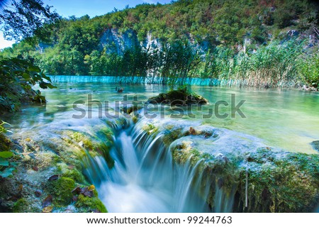 Waterfall and lake - stock photo