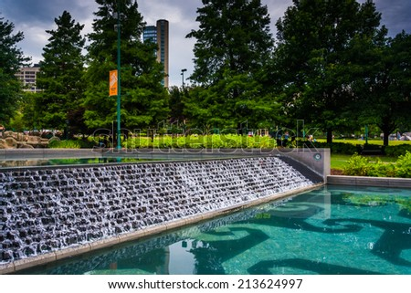 Waterfall and pool at Centennial Olympic Park in downtown Atlanta, Georgia. - stock photo