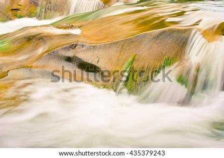 Waterfall and rocks - stock photo