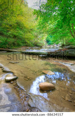 waterfall and water, forest in autumn - stock photo