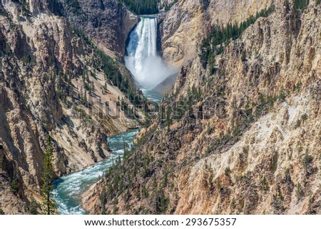 Waterfall at the Yellowstone National Park - stock photo