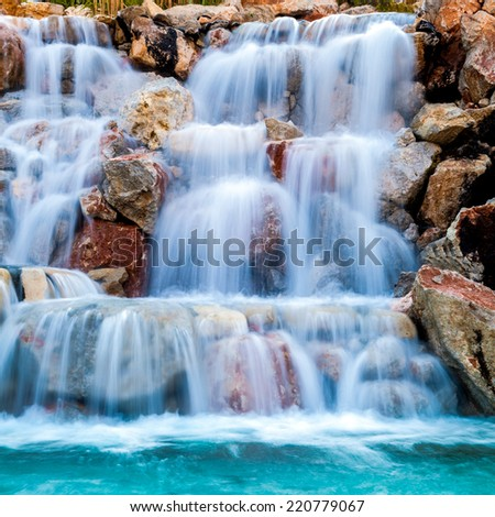 waterfall beautiful background of stone, water, moss.  - stock photo