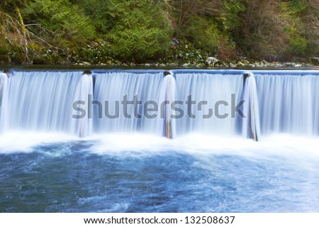 Waterfall cascade streaming down in the green forest - stock photo