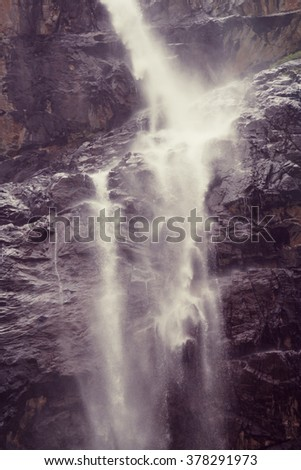 waterfall cascades in mountains  - stock photo