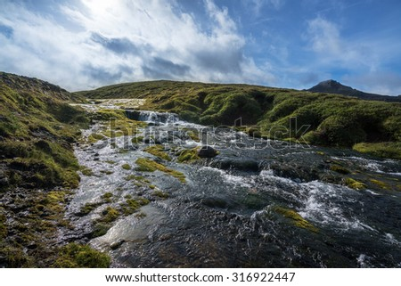 Waterfall cascades in the southern region of Iceland during summer - stock photo
