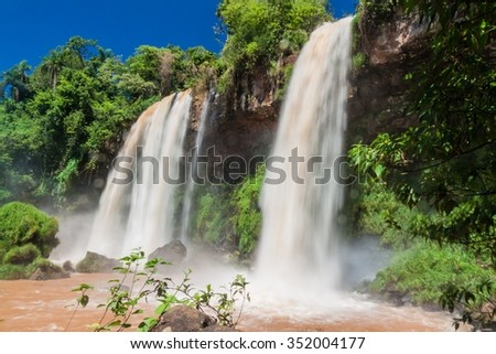 Waterfall Dos Hermanas (Two Sisters) at Iguacu (Iguazu) falls on a border of Brazil and Argentina - stock photo