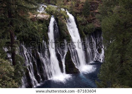 Waterfall: Evening above at the majestic 129 foot Burney Falls, located at McArthur Burney Falls Memorial State Park in Shasta County, California. Burney Creek flows from a natural spring. - stock photo