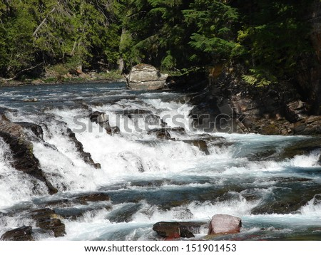 waterfall flowing over rocks - stock photo
