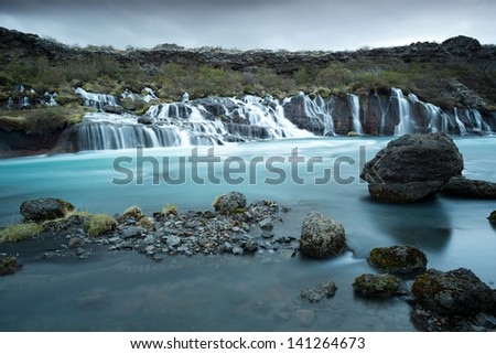 Waterfall Hraunfossar , Iceland - stock photo