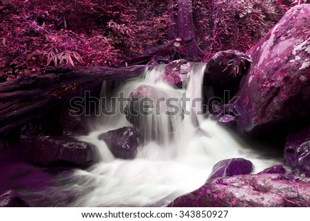 Waterfall in a forest ,Beautiful Waterfalls Krok I Dok, Saraburi, Thailand, Style light pink background - stock photo
