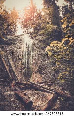 Waterfall in a forest in Slovak Paradise, Slovakia - stock photo