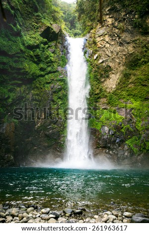 Waterfall in a mountain gorge, Philippines. - stock photo