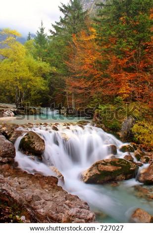 Waterfall in autumn - stock photo