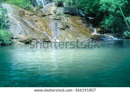 waterfall in bamboo forest - stock photo