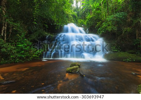 Waterfall in deep and fresh forest - stock photo