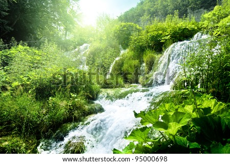 waterfall in deep forest - stock photo