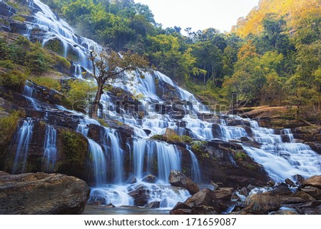 waterfall in deep forest as landscape - stock photo