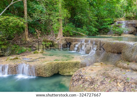 Waterfall in Deep forest at Erawan waterfall National Park. - stock photo