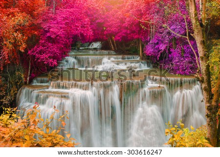 Waterfall in deep rain forest jungle (Huay Mae Kamin Waterfall in Kanchanaburi Province, Thailand) - stock photo