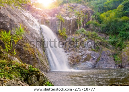 Waterfall in deep rain forest jungle. (Mae Re Wa Waterfalls Mokoju, Thailand) - stock photo