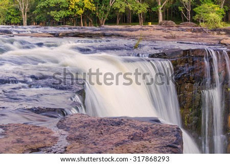 Waterfall in deep rain forest jungle. TadtonWaterfall Chaiyaphum, Thailand. - stock photo
