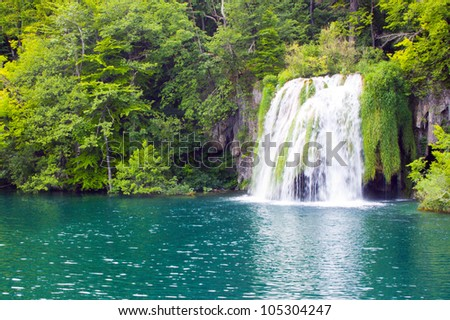 waterfall in forest lake, Plitvice, Croatia - stock photo