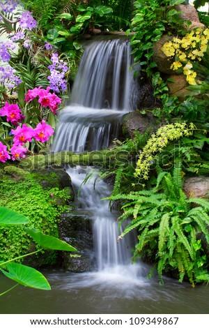 Waterfall in garden - stock photo