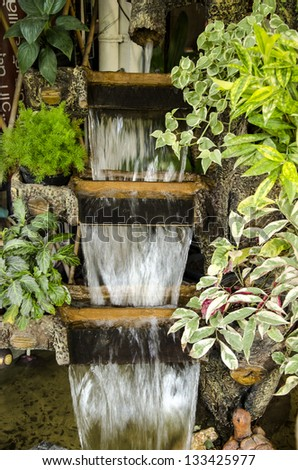 Waterfall in garden. - stock photo