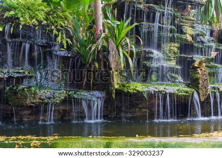 Waterfall in garden at the public park. - stock photo