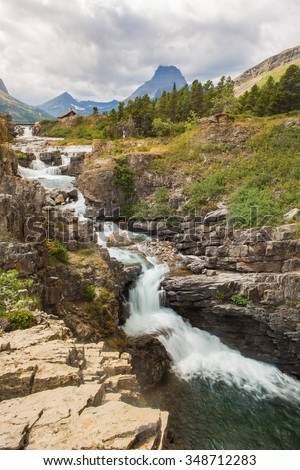 Waterfall in Glacier National Park - stock photo