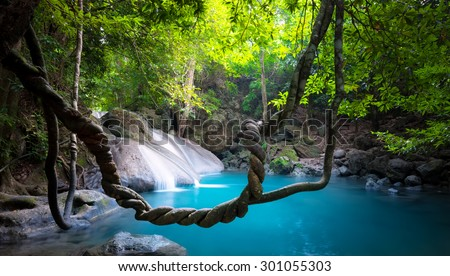 Waterfall in jungle forest nature background - stock photo