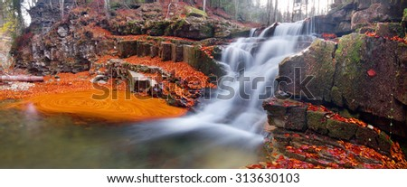 Waterfall in Manyava - the highest in the Carpathians, Ukraine. Clear water rivers and wild Manjavka beech forests - it is very beautiful in the autumn, on a background of gold and red leaves - stock photo