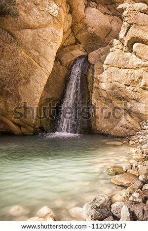 Waterfall in mountain oasis Chebika, Tunisia, Africa - stock photo