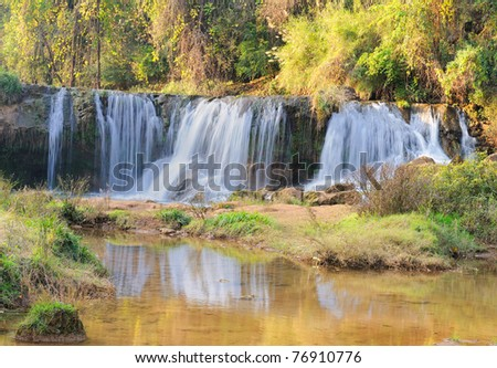 waterfall in mountains - stock photo
