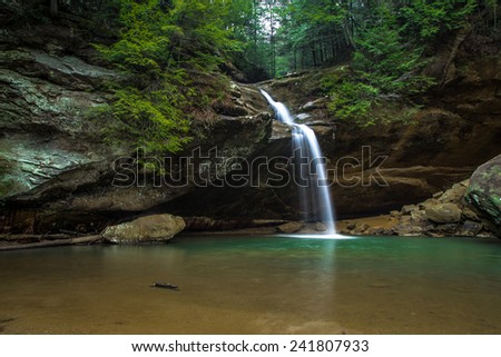 Waterfall In Paradise. Cascade along a hiking trail in Hocking Hills State Park. Logan, Ohio. - stock photo