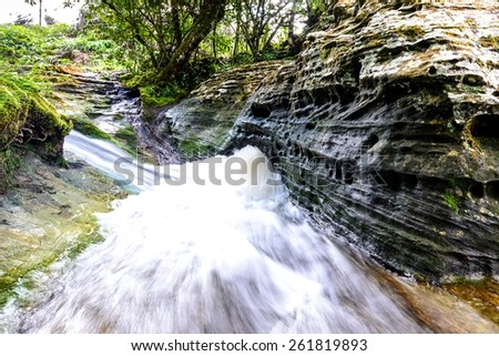 Waterfall in rainforest. - stock photo