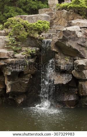 Waterfall in the Japanese Garden - stock photo