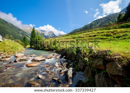 waterfall in the mountains in the national park Hohe Tauern in Austria. - stock photo