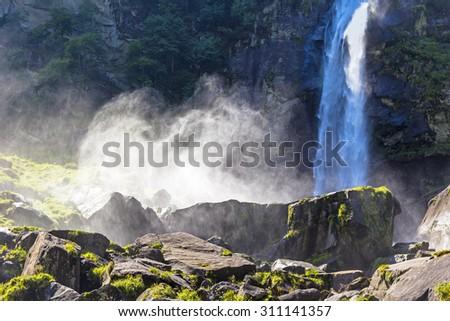 Waterfall in the Mountains. Was seen in Foroglio, Valle Bavona, Ticino, Switzerland. - stock photo