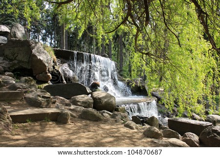 waterfall in the park in Warsaw - stock photo