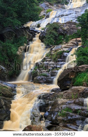 Waterfall in the rocky hills of Sri Lanka - stock photo