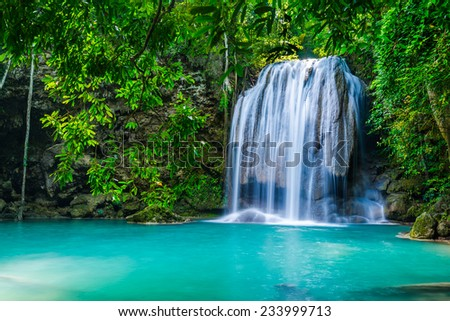 Waterfall in the tropical forest in Thailand - stock photo