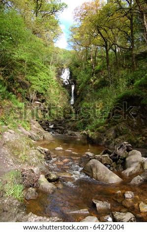 Waterfall in the Trossachs Queen Elizabeth park, Scotland - stock photo