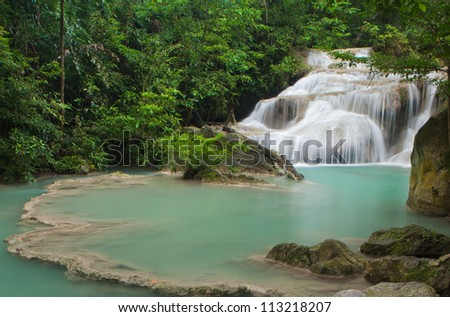 Waterfall in tropical forest at Erawan national park Kanchanaburi province, Thailand - stock photo