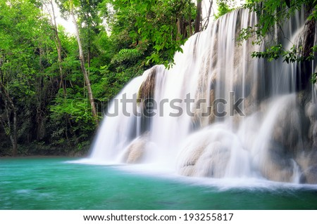Waterfall in tropical forest of Thailand - stock photo