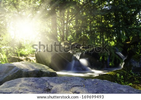 Waterfall landscape In the deep forest on mountain - stock photo