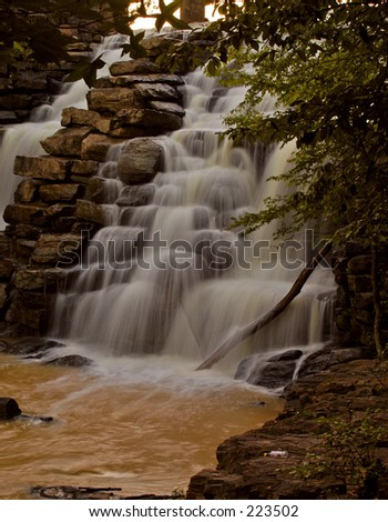Waterfall - murky water - stock photo