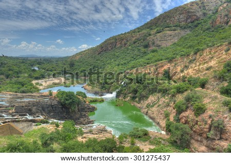 Waterfall of Crocodile River Hartbeespoort Dam in South Africa - stock photo