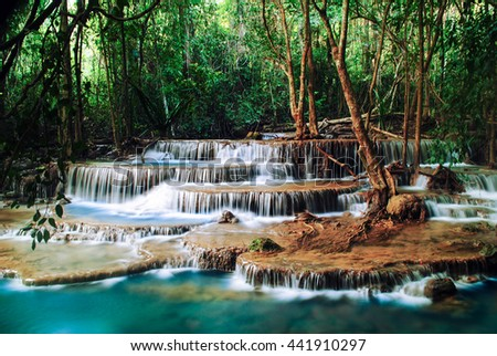 Waterfall on a mountain creek. In the foreground a wooden planks, Waterfall, Waterfall foreground a wooden,  - stock photo