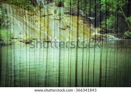 waterfall on old bamboo wall - stock photo